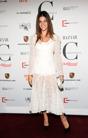 Julia Restoin-Roitfeld worked the sheer trend in this flower-embroidered white number during the 'Mademoiselle C' premiere.
