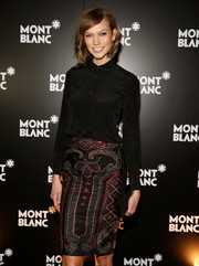 Karlie Kloss looked impeccable in a black button-down paired with a patterned skirt during the Montblanc Madison Avenue opening.