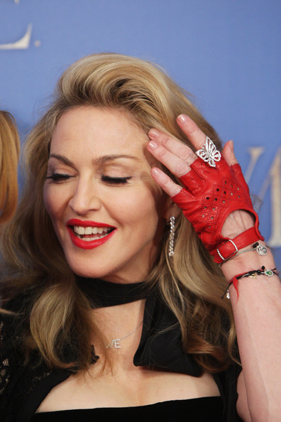 Madonna Fingerless Gloves [w.e.,hair,blond,lip,hairstyle,beauty,long hair,hand,glove,nail,nail care,madonna,uk,london,the odeon kensington,tabloid newspapers,premiere]