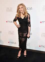 Madonna launched her new fragrance at Macy's Herald Square in an all-black ensemble she paired with simple peep toe platform pumps.