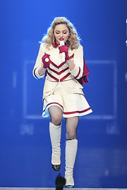 Madonna completed her marching band concert costume with knee-high white boots.