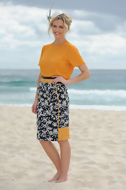 Brooklyn Decker posed on the beach in this colorful print frock.