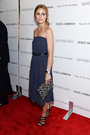 Olivia Palermo teamed her cute dress with edgy-sexy black strappy heels by Christian Louboutin.