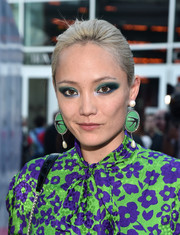 Pom Klementieff styled her hair into a simple bun for the premiere of 'Damsel.'