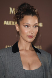 Bella Hadid adorned her lobes with a pair of oversized gold hoops.