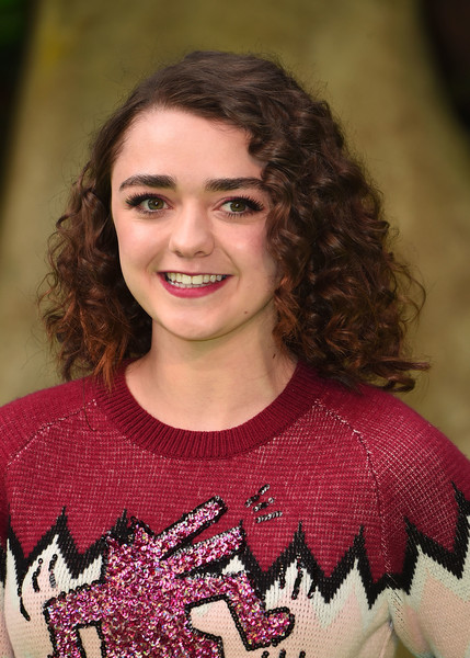 Maisie Williams Medium Curls [face,hair,beauty,pink,smile,t-shirt,brown hair,photography,long hair,red carpet arrivals,maisie williams,england,london,bfi imax,early man world premiere]