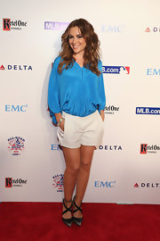 Alyssa Milano's sky blue blouse gave her a fun and summer look on the red carpet.