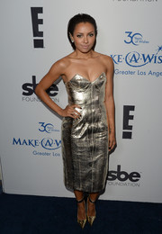 Kat Graham teamed gold ankle-strap pumps with her metallic dress for a totally shimmery look.
