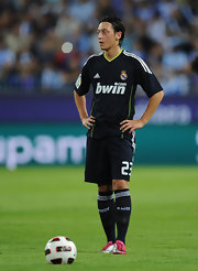 Mesut Ozil catches his breath while playing for Real Madrid.