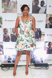 Alicia Quarles went the romantic route in a rose-print mini dress at the Malaika10 event.