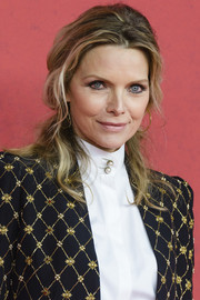 Michelle Pfeiffer was edgy-glam at the Berlin premiere of 'The Family' with this messy half-up half-down 'do.