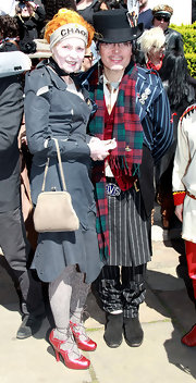 Vivienne Westwood complemented her elaborate outfit with a simple nude purse at the funeral of Malcolm McLaren.