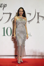 Angelina Jolie was flapper-glam in a fringed silver halter dress by Ralph & Russo Couture at the Japan premiere of 'Maleficent: Mistress of Evil.'
