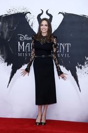 Angelina Jolie added a dose of edge with a  pair of spike-embellished pumps.