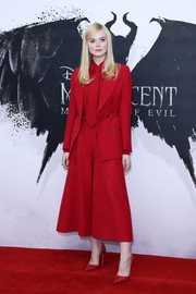 Elle Fanning opted for a red jacket and culottes combo by Gucci when she attended the 'Maleficent: Mistress of Evil' photocall in London.