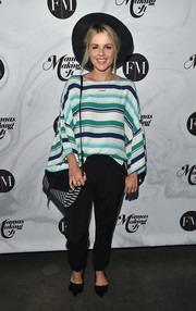 Ali Fedotowsky attended the Mamas Making It Summit wearing a loose striped blouse.