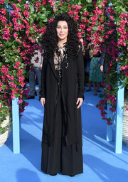 Cher teamed a deconstructed-chic duster with a sheer top and wide-leg pants for the world premiere of 'Mamma Mia! Here We Go Again.'
