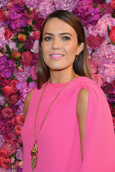 Mandy Moore Oversized Pendant Necklace [pink,lady,beauty,lip,shoulder,magenta,formal wear,event,smile,photography,schiaparelli,mandy moore,front row,part,paris,france,paris fashion week,show,schiaparelli haute couture fall winter 2018]