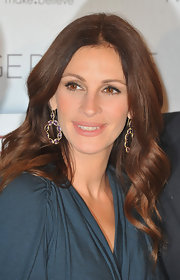 Julia opted for a beautiful pair of gold and purple dangle earrings while hitting a Paris premiere.