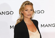 Kate Moss wore her hair in long layered locks in flowing waves at the launch of her new ad campaign for Mango.