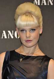 Micky Green amped up her LBD with a blond pompadour complete with blunt cut bangs.