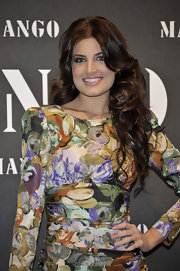 Paula Guillo finished off her floral dress with long flowing brunette curls.