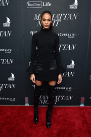 Joan Smalls teamed her dress with black thigh-high boots.