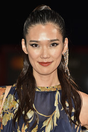 Tao Okamoto slicked her hair back into a tight ponytail for the Venice Film Festival premiere of 'Manhunt.'