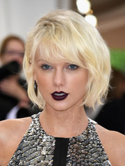 Taylor Swift highlighted her heart-shaped kisser with purple lipstick.