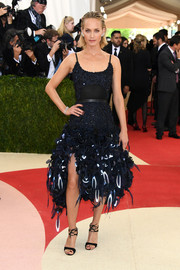 Amber Valletta paired her frilly dress with black ankle-tie heels.