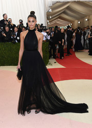 Taylor Hill stuck to classic glamour in a black tulle halter gown by Topshop for her Met Gala look.