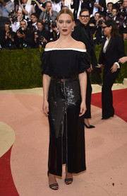 Lea Seydoux was all about bohemian elegance in a black off-the-shoulder dress by Louis Vuitton at the Met Gala.