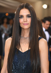 Katie Holmes framed her eyes with extra-long false lashes.