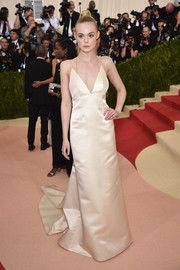 Elle Fanning looked downright regal at the Met Gala in an ivory Thakoon column dress with a long train.
