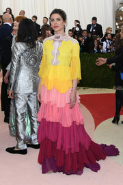Charlotte Casiraghi made a colorful appearance at the Met Gala wearing this tiered ruffle gown by Gucci.