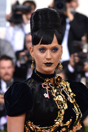 Katy Perry made her eyes pop with lots of purple shadow.