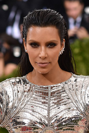 Kim Kardashian added more edge with a smoky eye.