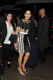 Freida Pinto added an extra pop of gold with a pair of strappy pumps.
