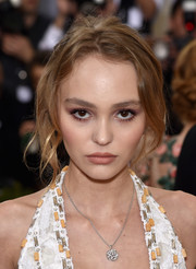 Lily-Rose Depp accessorized with a diamond pendant necklace by Chanel at the 2016 Met Gala.