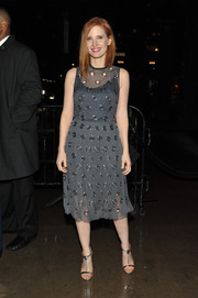 Jessica Chastain teamed her dress with silver T-strap sandals.