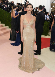 Lily Aldridge was a gilded goddess in a sparkly gold cutout gown by Michael Kors at the Met Gala.