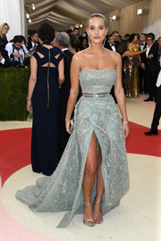 Hannah Davis was all about sexy glamour at the Met Gala in a strapless slate-blue Zuhair Murad gown with a high front slit.