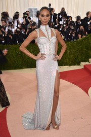 Joan Smalls looked fierce at the Met Gala in a fully beaded corset gown with yoke cutouts.