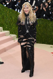 Madonna wore black over-the-knee boots for added oomph.