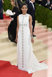 Freida Pinto was all about retro glamour at the Met Gala in an embellished white Tory Burch gown with a long train.