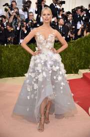 Karolina Kurkova married high technology with glamour in this gorgeous flower-appliqued, LED light-adorned gown, a collaboration between Marchesa and IBM Watson, for her Met Gala look.