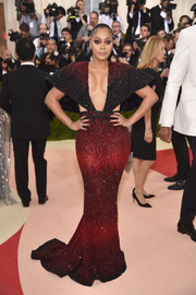 La La Anthony was all cleavage and curves in a red and black beaded gown by Nicolas Jebran at the Met Gala.