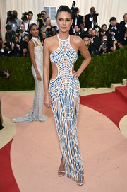 Kendall Jenner flaunted her model figure at the Met Gala in a Versace mosaic-inspired dress with waist cutouts.