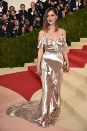 Rose Byrne went the classic, ultra-feminine route in a gold satin ruffle gown by Ralph Lauren for her Met Gala look.
