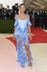 Irina Shayk looked coquettish at the Met Gala in a blue Givenchy corset gown with a sheer stars-and-stripes skirt.